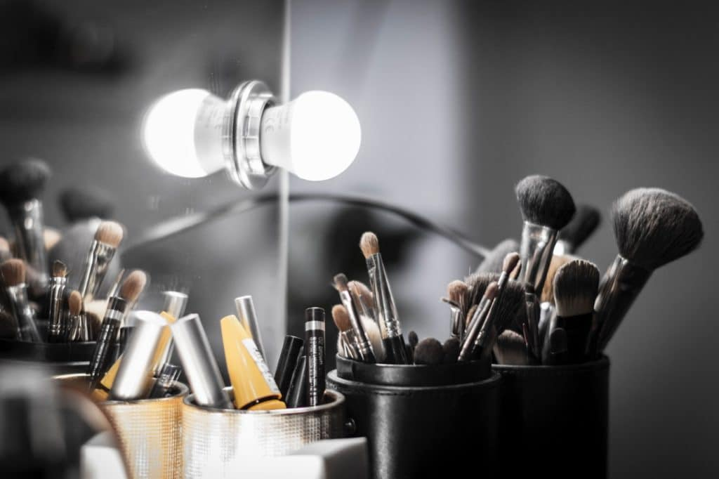 Natural white light is the perfect light for makeup application a Vanity mirror with a lot of makeup brushes in front of it