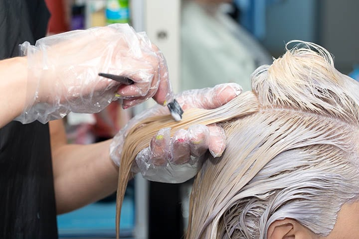 What happens if you apply a dark permanent hair dye over bleached hair