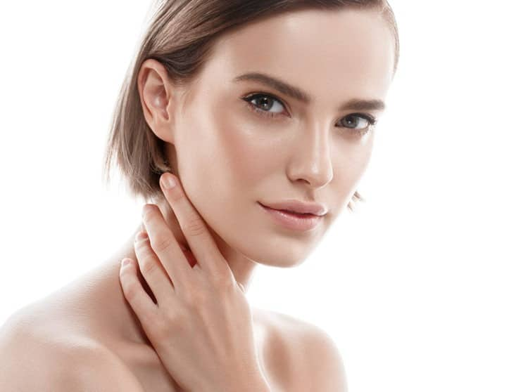Girl holding her wrinkle free face with no face lines