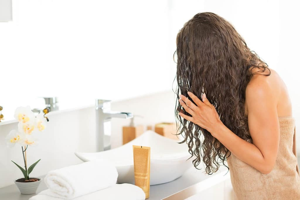 Applying dye to wet hair to protect it from damage