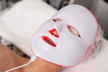 Young beautiful girl using LED light therapy