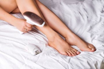 Girl using the philips lumia IPL device to remove hair from her legs