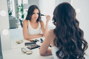 Girl doing her makeup like every day and wondering if it's going to make her age faster