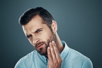 Man thinking of removing his beard with an IPL device