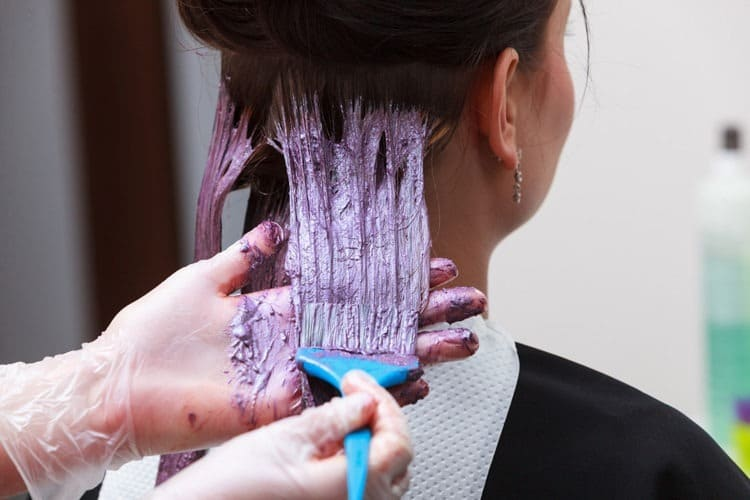 Girl applying permanent hair dye over semi permanent