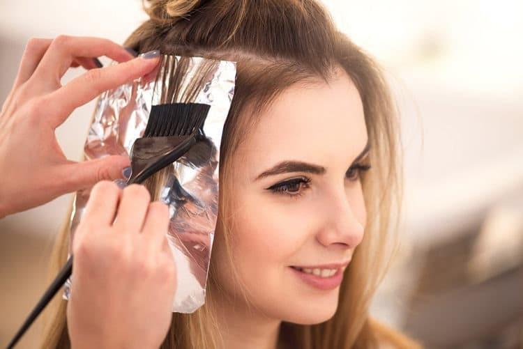 Girl applying dye on dry hair