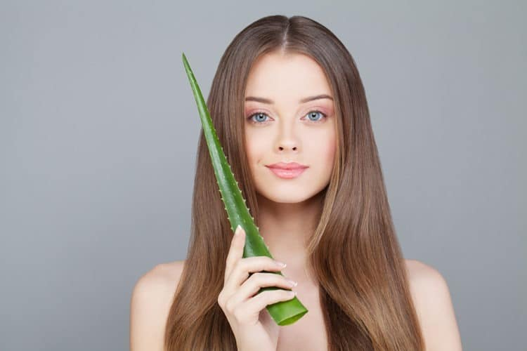Girl wondering if it's safe to sleep with aloe vera on her face