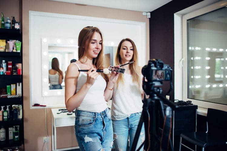Two girls doing a flawless makeup for a photo shoot