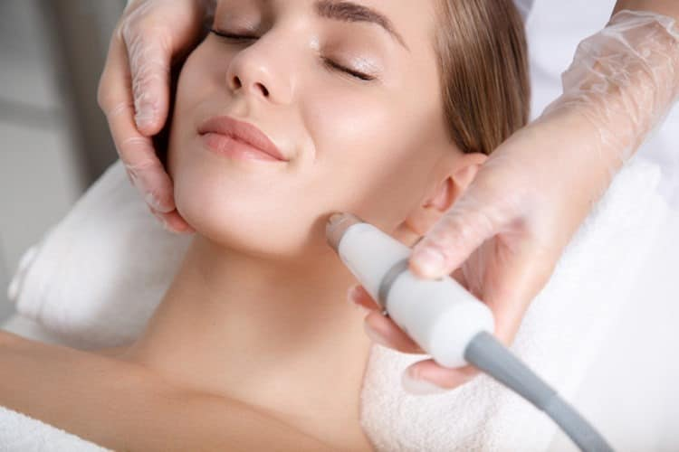 A beautiful girl getting a laser hair removal on her face
