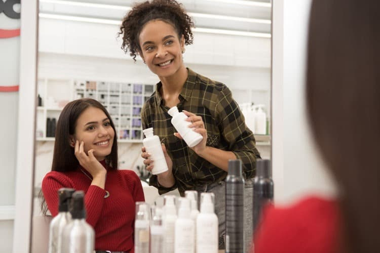 Girl choosing the right shampoo for her color treated hair