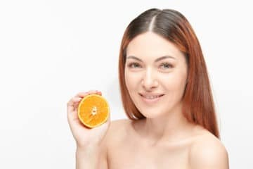 girl trying to get rid of orange hair after bleaching her hair