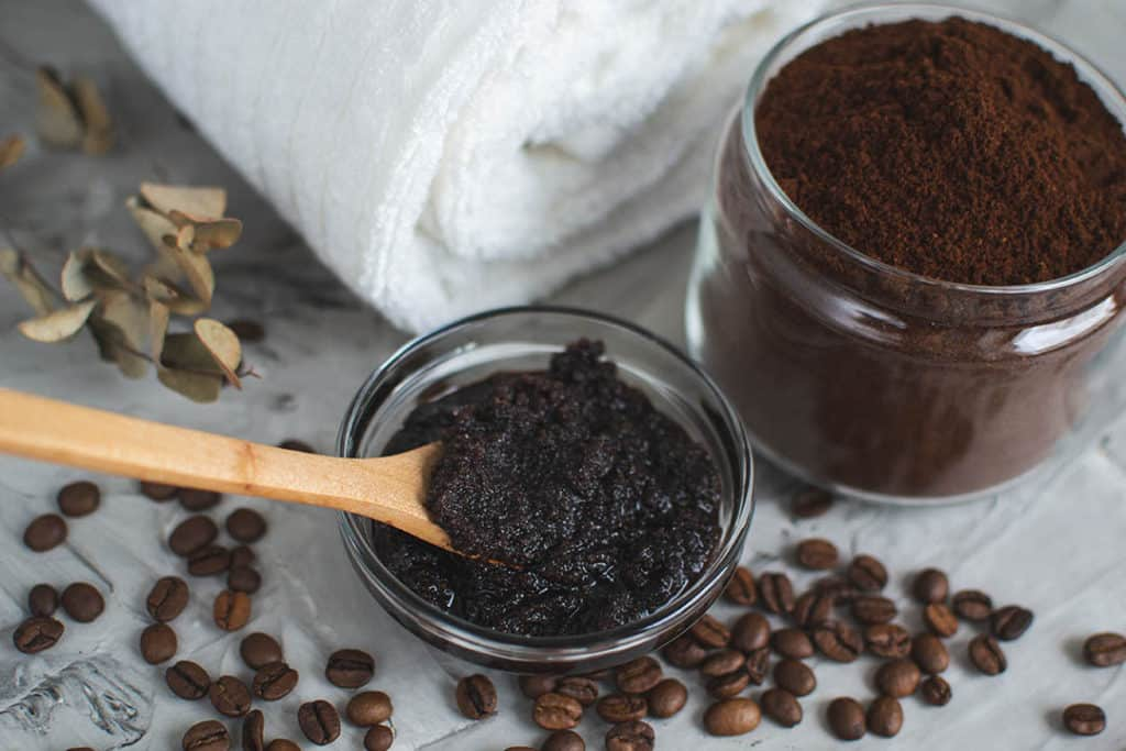 Coarse coffee grounds as a DIY scrub to detox your scalp